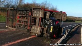 Overturned car transporter