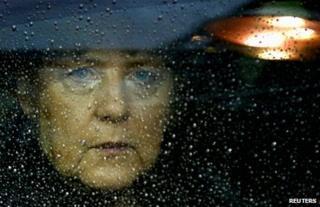 German Chancellor Angela Merkel arrives at the EU council headquarters in Brussels, 23 November