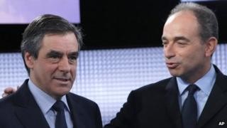 former French Prime Minister Francois Fillon, left, and French conservative party UMP secretary general Jean-Francois Cope pose for photographers