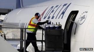 A Delta Airlines worker loads food onto a plane last week