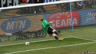 Germany goalkeeper dives as Frank Lampard shot bounces behind the line.