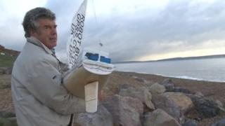 Snoopy Sloop launched from Barton-on-Sea beach