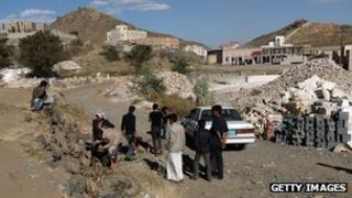 Yemeni men gather at the site of the attack