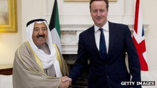 Emir of Kuwait Sheikh Sabah al-Ahmad al-Jaber al-Sabah (L) and British Prime Minister David Cameron