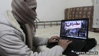 Syrian activist uses a computer in Damascus