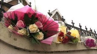 Floral tributes left at the scene of the crash