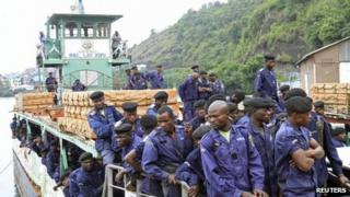 Congolese police officers arrive on a ferry at a port in Goma, 30 November 2012