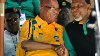 President Jacob Zuma (in yellow) shakes hands with his deputy Kgalema Motlanthe with expelled ANC Youth League leader Julius Malema wearing sunglasses behind