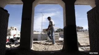 A labourer in the West Bank Jewish settlement of Maale Adumim, near Jerusalem, 2 December, 2012.