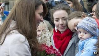Duchess of Cambridge meets parents and baby