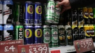 Cans of beer at supermarket