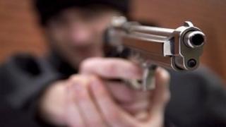 Generic image of man holding a gun