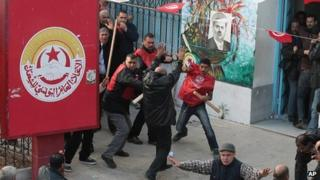 Members of the UGTT union clash with pro-government supporters