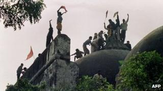 file photograph taken on December 6, 1992, Hindu youths clamour atop the 16th century Muslim Babri Mosque five hours before the structure was completely demolished by hundreds supporting Hindu fundamentalist activists in Ayodhya.