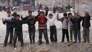 Syrian children flash victory signs