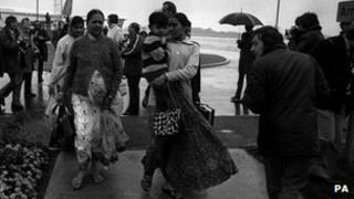 Asian immigrants from the Uganda arrive in Britain, circa 1972