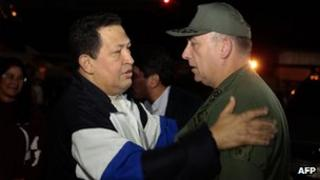Handout photo of Hugo Chavez meeting ministers at the airport in Caracus on 7/12/12