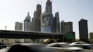 Cars pass by a picture of the prime minister and president of the UAE at Internet City in Dubai (file)