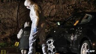 Forensics team examines a bullet-ridden car in Calvi. Photo: 7 December 2012