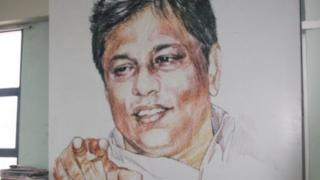 Portrait of Lasantha Wickrematunge in the Leader's offices