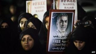 Women in Bahrain hold up a placard calling for the release of Nabeel Rajab (10 December 2012)