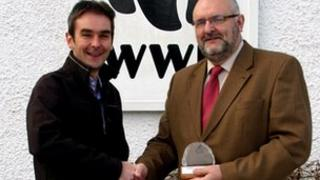 Dr Dan Barlow, Head of Policy at WWF Scotland, left, handing award to retired Superintendent Alan Smailes