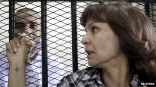 The mother of Alber Saber (left) reacts during a court hearing on 26 September 2012