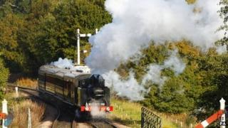 Steam engine carries Bernard Holden's coffin along the Bluebell Railway