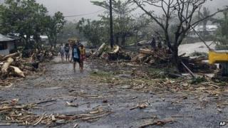 People walk through debris in Samoa's capital Apia. Photo: 14 December 2012