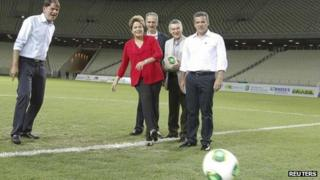 Brazilian President Dilma Rousseff kicks a ball in the Castelao Arena on 16 December