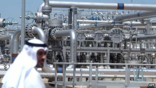 A worker walks at Gathering Centre 15 (GC 15) oil facility in the northern al-Rawdhatain oilfield, Kuwait (2005)