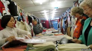 A Vietnamese immigrant sells clothes in a shop in Warsaw