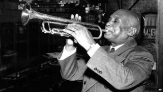 WC Handy playing a trumpet