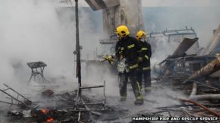 Fire-fighters tackle the blaze at the farm in Colemore