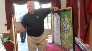 Peter Barrell auctioning a signed England shirt