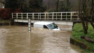 Van driver stuck in flooded Barwick Ford in Hertfordshire