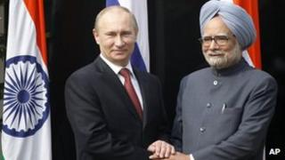 Russian President Vladimir Putin, left, shakes hands with Indian Prime Minister Manmohan Singh, right, before a meeting at his residence in New Delhi, India, Monday, December 24, 2012.