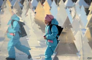 A child walks through Gorky Park, Moscow, 24 December