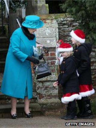 The Queen speaks to two children outside church