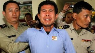 Born Samnang (centre) in court on 27 December 2012