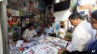 Burmese people buying newspapers on 28 December 2012