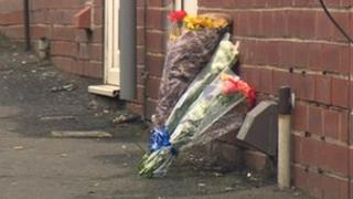 Flowers at scene of Mr Topping's death at Goldthorpe, South Yorkshire
