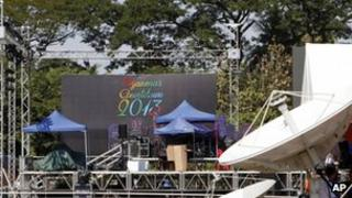 Workers resting as they prepare to set up a stage for the country's first-ever public New Year's countdown at Myoma grounds in Rangoon, 31 December 2012.