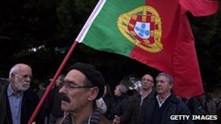 Portuguese protester holding flag