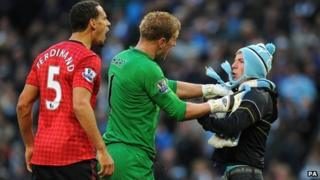 Matthew Stott being restrained by Joe Hart during the Manchester derby