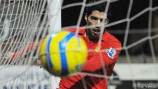 Suarez scores controversial goal