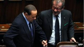 Silvio Berlusconi and Roberto Maroni in parliament (file pic, 2011)