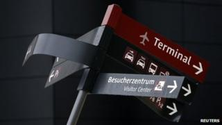 A damaged sign is pictured at the construction site of the future Berlin Brandenburg international airport