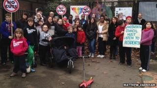 Children and protesters at the park