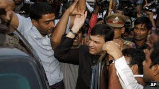 Muslim lawmaker and the leader of Majlis-e-Ittehadul Muslimeen, or the Council of the Union of Muslims, Akbaruddin Owaisi, center in black, makes his way through the crowd as he leaves the Government Gandhi Hospital after medical tests in Hyderabad, India, Tuesday, Jan. 8, 2013